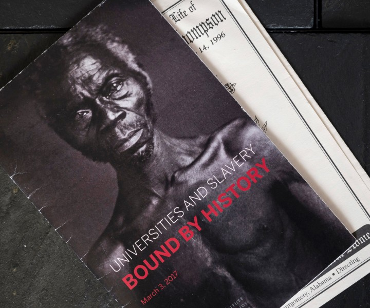 A program for a 2017 conference at Harvard on the links between academia and slavery. The program bears the image of Renty, a slave from whom Ms. Lanier says she descended.CreditKarsten Moran for The New York Times